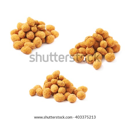 Pile of spicy flavour crunchy coated nuts isolated over the white background, set of three different foreshortenings - stock photo