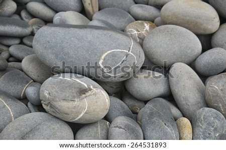 Pile of stones beach pebbles background  - stock photo
