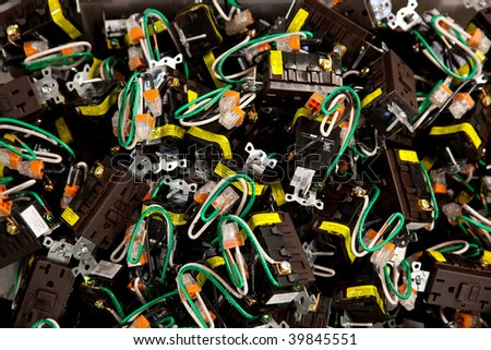 Pile of stripped electrical/power outlets - stock photo
