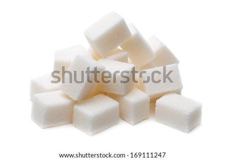 Pile of Sugar lumps, isolated on a white background. - stock photo