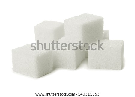 Pile of sugar lumps isolated on white - stock photo