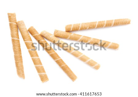 Pile of sweet wafel sticks isolated over the white background - stock photo