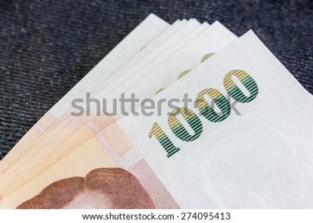 Pile of thai money. One thousand baht note. - stock photo