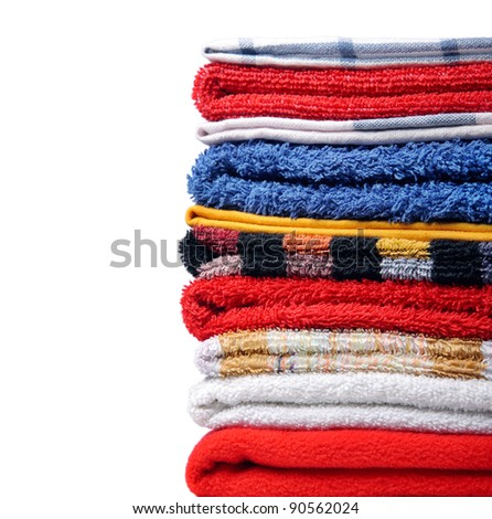 Pile of towels on white background - stock photo