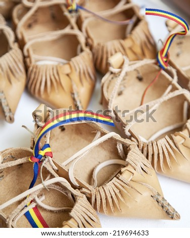 Pile of traditional Romanian peasant sandals - stock photo
