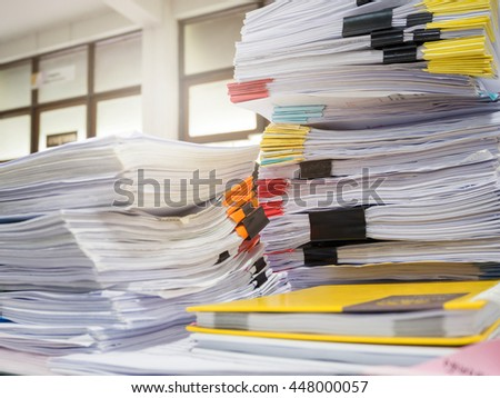 Pile of unfinished documents on office desk, Stack of business paper - stock photo
