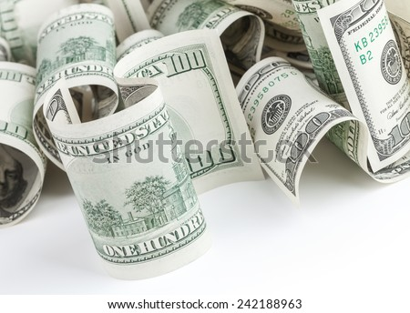 Pile of United States dollar hundred USD banknotes on white table. Selective focus - stock photo