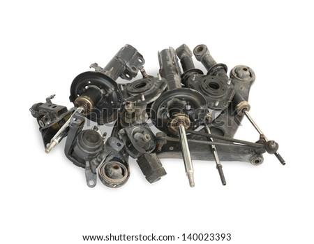 Pile of used auto parts isolated on white background - stock photo