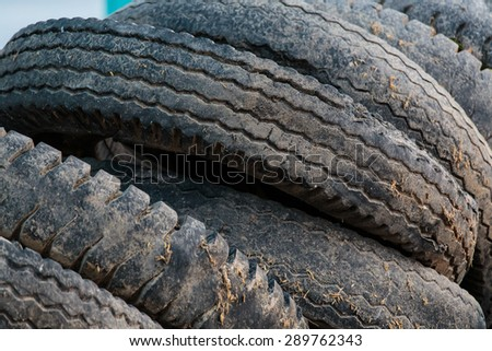 Pile of used old rubber tire - stock photo