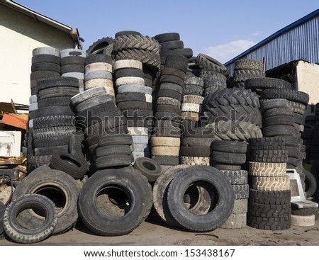 Pile of used tires - stock photo
