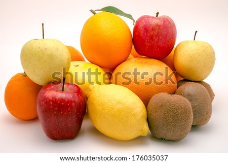 Pile of various fruits isolated on a white background - stock photo