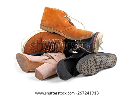 pile of various shoes isolated on white background - stock photo