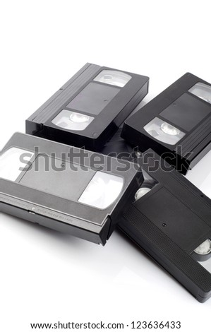 Pile of video cassettes isolated on white background. - stock photo