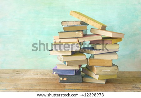 pile of vintage books,grungy background,free copy space - stock photo