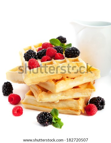 Pile of waffles with fresh berries - stock photo