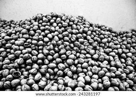 pile of walnuts against a wall - stock photo