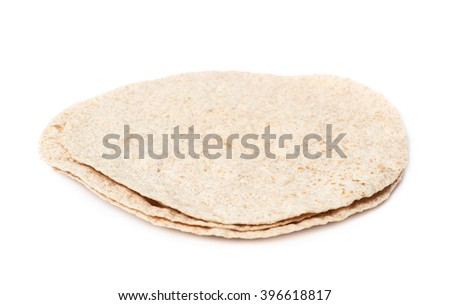 Pile of wheat tortillas isolated - stock photo