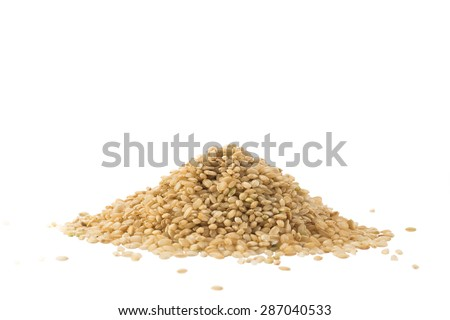 Pile of whole brown rice isolated on white background - stock photo