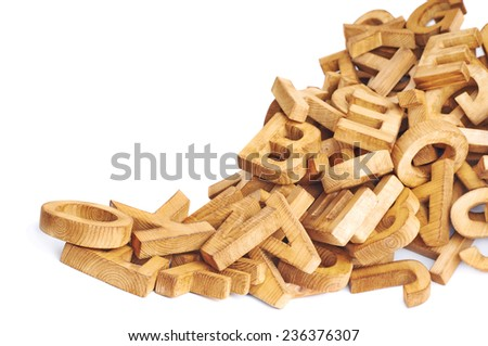 Pile of wooden block letters isolated over the white background as a typography background composition - stock photo