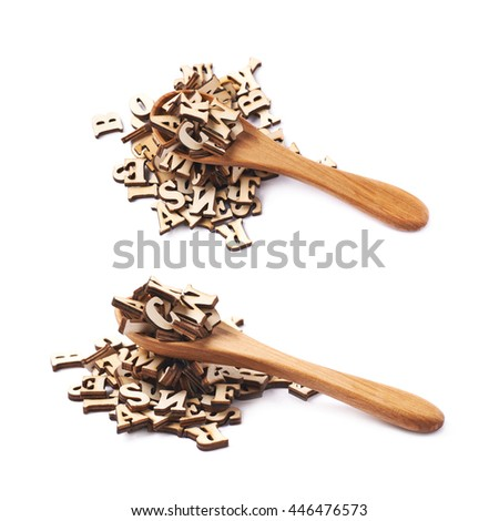Pile of wooden letters with a wooden cooking spoon over it, composition isolated over the white background, set of two different foreshortenings - stock photo