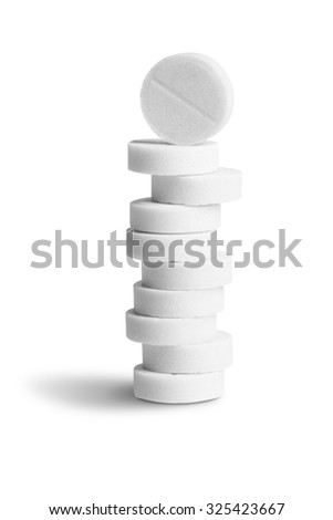 Pile (stack) of white pills isolated on white background - stock photo