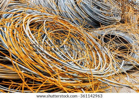 Pile up clutter rusty metal steel wire in Steel mills - stock photo