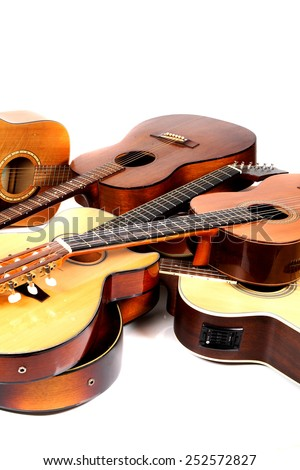 pile-up of many different acoustic guitars - stock photo