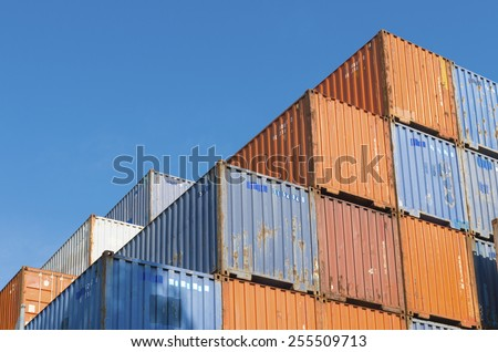 Piled up cargo containers in the rotterdam port. It is the largest port in Europe, covering 105 square kilometers (41 sq miles) - stock photo