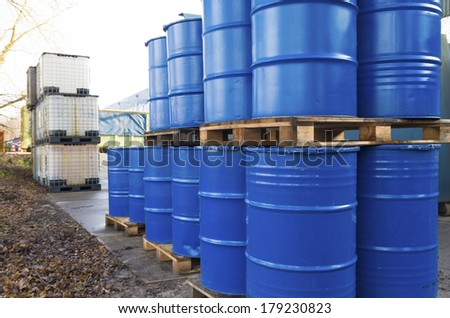 piled up empty blue oil barrels - stock photo
