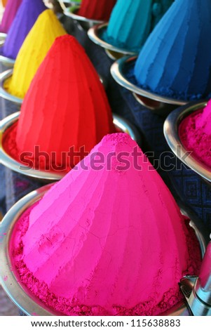 Piles & mounds of colorful dye powders for holi festival & other religious uses commonly found in indian markets. These dry flour heaps were taken at mysore bazaar, india & used mainly for rangoli - stock photo