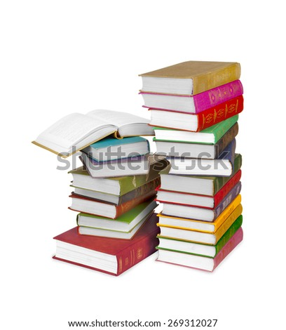 Piles of books isolated on white background - stock photo