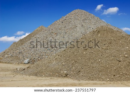 Piles of building construction sand. Sand for construction. - stock photo