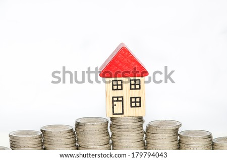 piles of coins and a house - stock photo