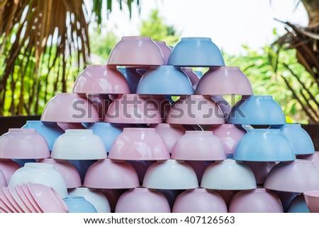 Piles of colorful plastic crockery bowl  - stock photo