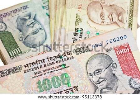 Piles of large bills in Indian currency. - stock photo
