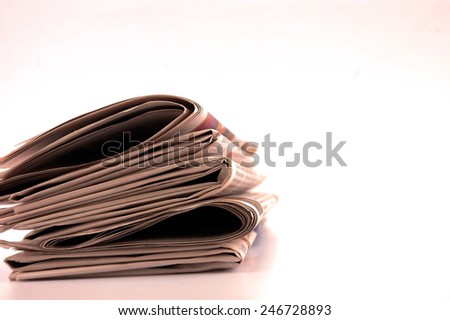 Piles of newspapers isolated on white, SOFT FOCUS - stock photo