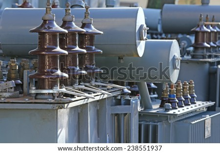 piles of old voltage transformers in a landfill of electrical equipment to be recycled - stock photo