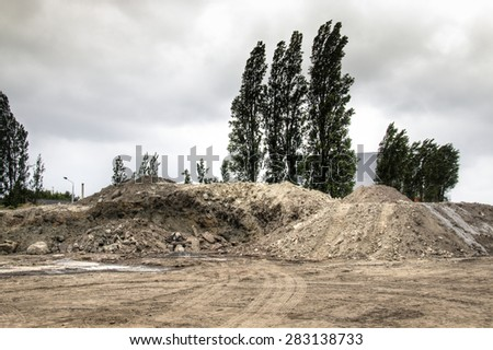 Piles of sand and dirt at construction works in the harbour of Antwerp, Belgium  - stock photo