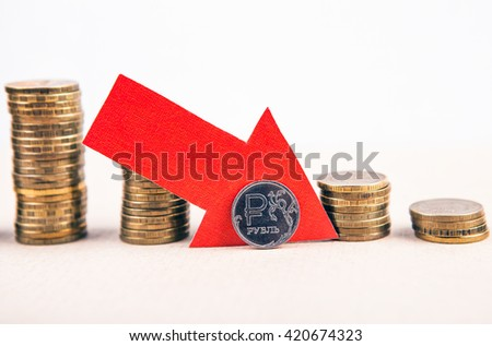 Piles of the Coins the Russian Ruble Down - stock photo