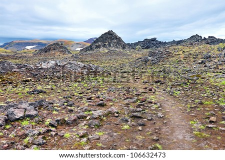 Piles of volcanic slag at the foot of the Gorely volcano, Far east, Russia, Kamchatka - stock photo