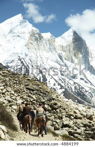 Piligrims in Himalayan mountain - stock photo