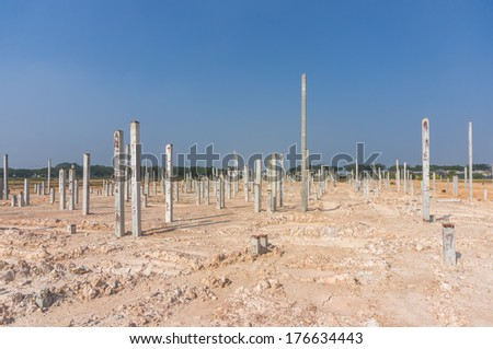 Piling work at construction site with blue skies background - stock photo