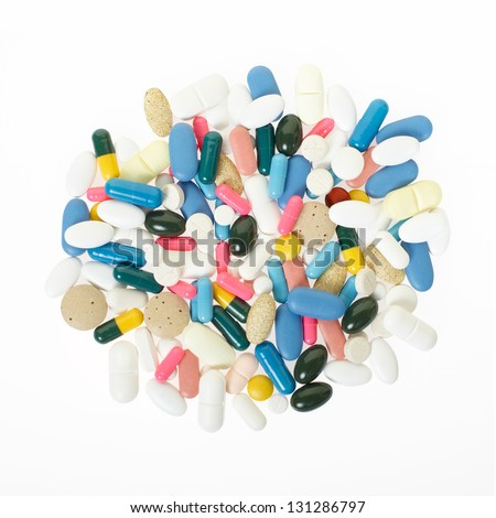 Pill and colorful medical capsule on white, clipping path included - stock photo
