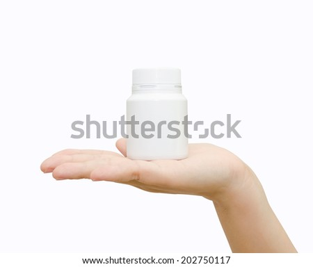 Pill bottle on hand isolated on white background - stock photo