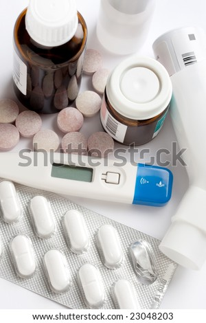 pill containers, tablets and thermometer - stock photo