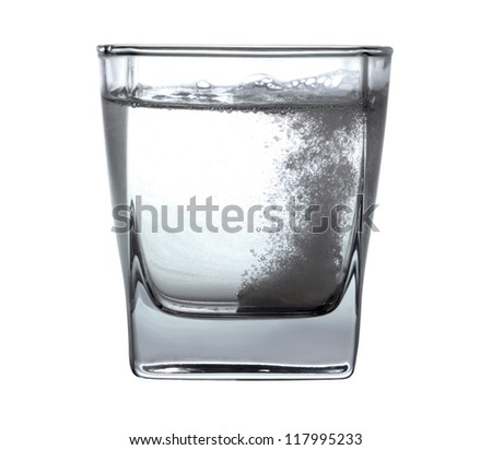 Pill in glass of water - stock photo