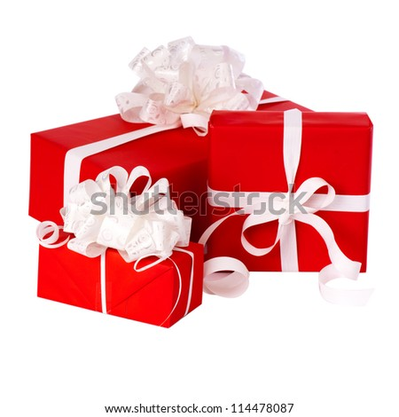 Pillar of boxes with presents wrapped in red paper, isolated on white - stock photo