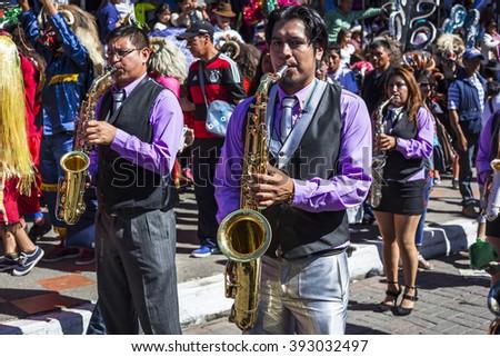 Pillaro, ECUADOR - FEBRUARY 6, 2016: Bands encourage and accompany the groups on the feast of the diabladas of Pillaro - stock photo