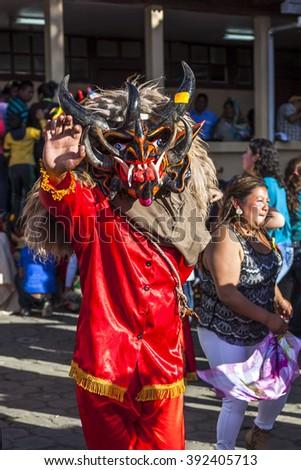 Pillaro, ECUADOR - FEBRUARY 6, 2016: Unidentified man, dressed as Devil in the diabladas festivities in Pillaro. - stock photo