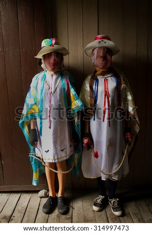 PILLARO, ECUADOR - JANUARY 4, 2014: Unknown locals dressed up participating in the Diablada, popular town celebrations with people dressed as devils dancing in the streets - stock photo